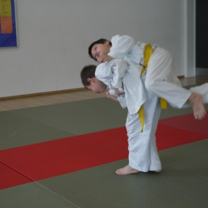 Two juniors practising ju jitsu throws